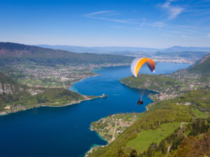 France - Auvergne Rhone Alpes - Annecy - Beautiful view of paragliding in Annecy - shutterstock